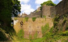 Rare Panorama of Canons Gate Caponier, Western Outer Curtain Wall, Dover Castle, Kent, England, UK. The Canons Gate (Canons Gateway) Caponier, Drawbridge, and Bridge viewed from near the edge of the White Cliffs of Dover. Built 1797 by Colonel William Twiss RE (Royal Engineers) during Napoleonic Wars. Also: Tudor Bulwark and Rokesley Tower. Listed Building, English Heritage site, and Ancient Monument. British Army, Norman History, Travel and Tourism. See…