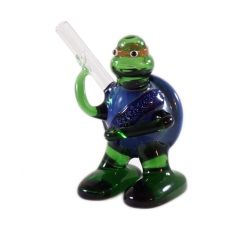 Glass Pipe - Ninja Turtle.  This hand blown glass Ninja Turtle pipe has a beautifully intricate design.  The flat base makes the pipe free-standing, making it easier to pick up and put down.  Specs: Hand blown glass; Rush hole on side; 85mm (h).  For more information please click the link or visit dotcombong.com.
