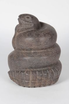 Aztec CE 1325-1475 Important stone carved sculpture of a coiled serpent