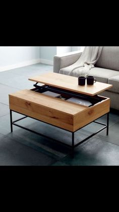 west elm coffee table Mango wood top and metal legs Top also pops up for storage inside, 1144551596