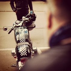 Love the racing checkerboard.  I think this may be a Triumph.  Gorgeous.