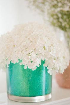 Glitter vases awesome center pieces...witj gold glitter and coral flowers