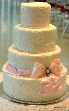 Lace cake. Gorgeous. love the detail. i can imagine it with a purple ribbon, and maybe even purple instead of ivory pearls around the layers