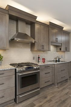 Kitchen Gallery - Taupe Cabinets and Flooring with Granite Counters Kitchen Cabinets And Flooring, Stained Kitchen Cabinets, Granite Kitchen Counters, Rustic Kitchen Cabinets, Kitchen Cabinet Styles, Wood Cabinets, Staining Cabinets, Brown Cabinets, Kitchen Utensils