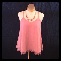Pink Blouse Pink blouse with beautiful detailing. Size M. Lace trim on the bottom layer of the shirt. Spaghetti straps are adjustable. I only wore this top one time so it is in excellent condition! One clothing Tops Camisoles