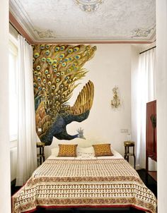 A bedroom in Ismail Acar's home has a wall painting by the artist. WSJ