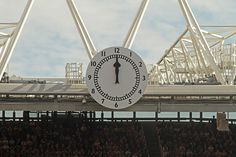 The clock end at the Arsenal Football Club's Emirates Stadium. By Ronnie Macdonald, via Flickr.