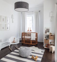 25 Creative and Beautiful Nursery Design Ideas via Brit + Co. White and natural wood nursery with an oval crib Wood Nursery, Nursery Modern, Nursery Neutral, Nursery Room, White Nursery, Modern Nurseries, Neutral Nurseries, Nursery Decor, Minimalist Nursery