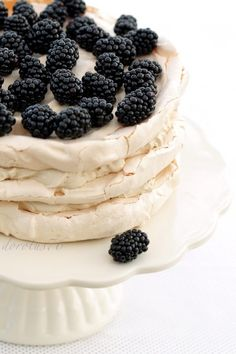 Meringue Layered with Coffee Cream Filling and Topped with Fresh Berries