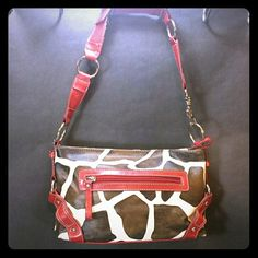 """Betty Boop Red Brown Giraffe Print Baguette In EUC with slight red discoloration near zipper Cute small size handbag. Measures 7"""" top to bottom, 11"""" side to side and 3 1/4"""" bottom  Handles with no damage except a few loose threads. Silver hardware  Zipper pocket on front  Zipper closure  Betty Boop printed words on the inside interior  Zipper inside pocket  Three small inner pockets for cell phones or keys   Purchase with confidence:  Fast Shipper  Top 10% Seller   TRS   Serviced over 150…"""