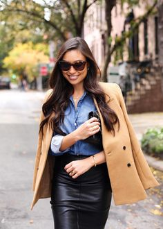 Kat Tanita from With Love from Kat looks super chic in this fall street style ensemble. She wears a denim button down tucked into a black leather pencil skirt, and tops off the look with our camel double-breasted blazer | Banana Republic