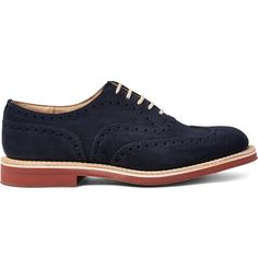 A brand that has outfitted the likes of Messrs Nick Wooster, Pierce Brosnan and Daniel Craig, Church's is adept at creating smart shoes that outlive trends. These 'Downton' brogues have been crafted from navy suede in a sleek Oxford profile and are set on brick-red soles that offer a stylish contrast.