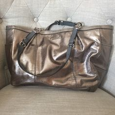 Coach metallic purse Silver metallic coach tote/purse. Large enough to be used as a work bag. Excellent condition Coach Bags Totes