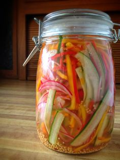 Refrigerator Pickle Salad 1/2 English cucumber 1/2 large red onion 8 oz sweet peepers ( about 8 ) 5 cloves of garlic  1 1/2 cups white vinegar 2/3 cup sugar 2 tablespoons salt  1 cup water 1 1/2 cup ice 1 oz mustard seeds Prep and combine cucumber, red onion, sweet peppers & garlic. Combine vinegar, sugar, salt and 1 cup of water in a small saucepan; stir well. Bring to a boil; cook 1 minute. Remove from heat, add ice to vinegar mixture. Pour over cucumber mixture. Cover and chill 3 days.