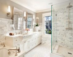 Love this gorgeous bathroom! Benjamin Moore Revere Pewter on walls and White Dove on cabinets, marble tile in shower (maybe Calcutta Gold?)