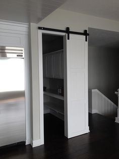 Lake House. Barn door used for the pantry door instead of a swing door to have the ease of opening without the having the door in the way. Also looks great!