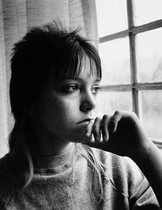 Tiny looking out a window in juvenile detention, 1983. © Mary Ellen Mark pb