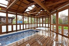 Original Endless Pools® - a rustic sunroom installation with plenty of exposed wood and natural light