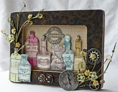 Altered Frame with Olde Curiosity Shoppe papers and stamps (by Gloria)