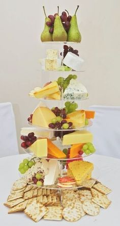 Cheese Buffet ....beautiful presentation but for a photograph...how the heck do you eat it? LOL grab a hunk of cheese and snack....oh I get it, it's decor for a cracker tray