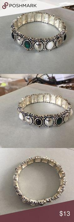 Premier Designs bracelet Premier designs stretch metal bracelet. Has silver white green and black stones. Signed on the inside. Great condition. Premier Designs Jewelry Bracelets