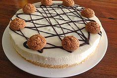 Amaretto Mousse Cheesecake | BODEN: 200g Löffelbiskuits, 100g Margarine (oder zimmerwarme Butter), 2 Beutel Gelatine (gemahlene weiße); 800g Frischkäse, 300g Zucker, 1Pck. Vanillinzucker, 130ml Kondensmilch, 1EL Zitronensaft, 100ml Amaretto, 250g Sahne | DEKORATION: Kuchenglasur (zartbitter), Kekse (Amarettinis)