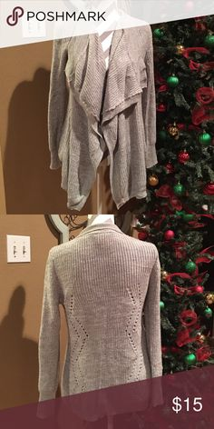 Adorable drape cardigan Cardigans are essential to any wardrobe! This drape cardigan has a flattering fit through the back and a drape front completes the look!! Gray is such a great neutral color and goes well with just about anything. 💕 super soft and cuddly. Size small. Sweaters Cardigans