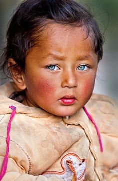 Nepalese child with piercing blue eyes.