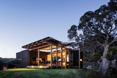 Castle Rock Beach House designed in 2014 by Herbst Architects is located in Auckland, New Zealand.