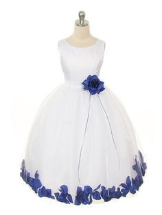 Adorable sleeveless satin flower girl dress with a calf-length tulle skirt with loose petals in the hem and a co-ordinating detachable flower at the