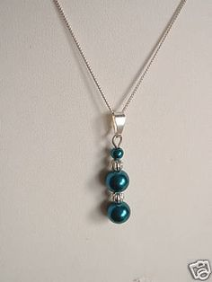 Handmade teal glass pearl and sterling silver necklace Made using teal glass pearls and silver spacer beads Chain size 16 inches  See sizing options