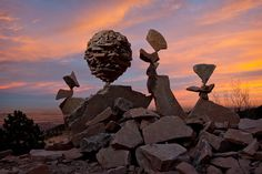 These rocks, says the artist, are not glued, not Velcroed. This is not a trick. There are big rocks pirouetting on little ones, little ones dangling on top of big ones, pebbles tightly clumped and suspended in air ...see photos from the artist Michael Grab, who executes these stunning natural displays.