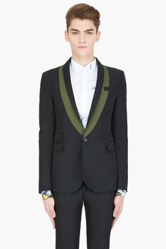 Mcq Alexander Mcqueen Deep Navy Tux Blazer -  Mcq Alexander Mcqueen Deep Navy Tux Blazer Mcq Alexander Mcqueen Long sleeve tuxedo blazer in deep navy blue. Shawl collar set against in green contrast fabric. Single_button closure at front. Padded shoulders. Flap pockets. welt pocket. and ticket pocket at front. Vented at back seam. Welt...
