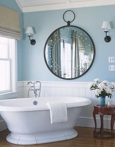ahhhhh....  soaker tub.... wainscotting, love the mirror.