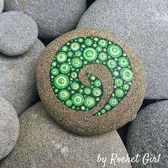 Green and Black Koru painted rock