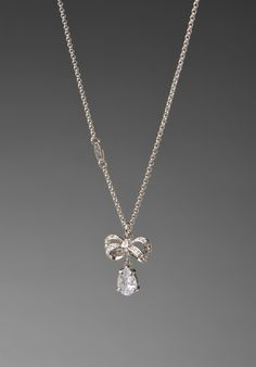 From:  Juicy Couture:  icon pave bow drop necklace in silver