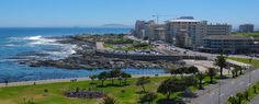 Panoramic view of Sea Point Promenade. Huge public swimming pool, walks with dogs, joggers, speedwalkers or just families and couples taking a stroll.ON the beach in Cape Town.