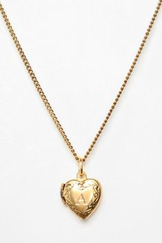 Initial Heart Locket Necklace from Urban Outfitters. Saved to Epic Wishlist. Shop more products from Urban Outfitters on Wanelo. I Love Jewelry, Jewelry Shop, Jewelry Accessories, Fashion Jewelry, Jewellery Market, Heart Locket Necklace, Dainty Necklace, Great Valentines Day Gifts, Pandora