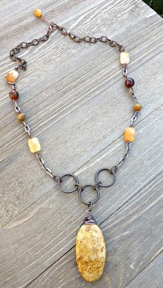 Stone and copper wire wrapped pendant necklace.  Yellow and brown stone, chain, metal jewelry.