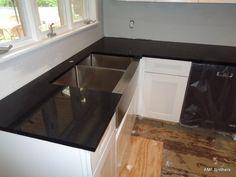 Crystal Black -  Elmhurst IL - http://www.amfgranite.com/quartz-countertops-projects/crystal-black-elmhurst-il/