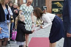 All smiles: The Hobart-born royal looks delighted as she accepts a posy of flowers from a little girl