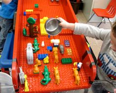 SAND AND WATER TABLES: DUPLO BOARD RAMP