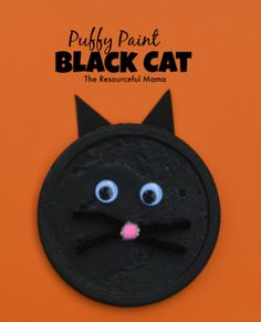 This black cat kid craft is made with a product from the recycling bin and DIY puffy paint. It is a great craft project for Halloween.