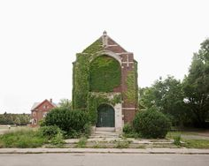 James Griffioen's Feral Church #2 documents the plant life in Detroit as people leave and the natural world begins to take over...