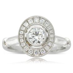 18ct white gold .50ct diamond halo engagement  ring