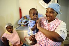 Stephane De Sakutin  A nurse plays with a child in an orphanage in Bulembu, Swaziland, on March 1, 2012.