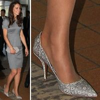 These lizard skin heels are from Tabitha Simmon's 2011 collection.  The pumps feature a lizard skin upper in a shade of silvery grey and cream. They have a scalloped back and pointed toe. The Duchess of Cambridge wore them during the Royal Tour of Canada in 2011, when she and Prince William participated in a tree-planting ceremony at Government House, followed by a visit to the Canadian War Museum.