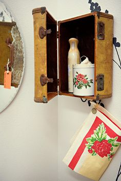 DIY medicine cabinet from a old suitcase!  Design Sponge is a awesome site.    http://www.designsponge.com/2012/01/diy-project-suitcase-vanity-towel-holder.html