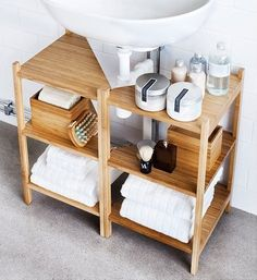 These RÅGRUND shelves from IKEA are designed to fit around a pedestal sink or the pipe of a wall-mounted sink.
