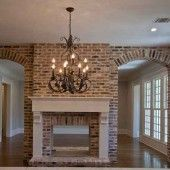 Cedar Hill Farmhouse:  Kitchen with two-way fireplace.  Love it!